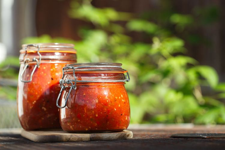 24107016 - jar of home made classic spicy tomato, chillie, garlic and peper sauce salsa
